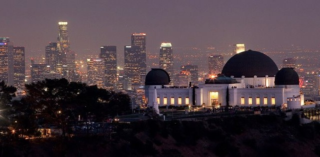 The Giffith Observatory and Los Angeles skyline at night. Photo by John Schreiber