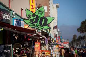 A sign advertising exams for medical marijuana prescriptions along the Venice Beach boardwalk. Photo by John Schreiber.