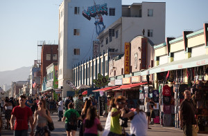 Shops and visitors along the Venice Beach Boardwalk in Los Angeles. Photo by John Schreiber.