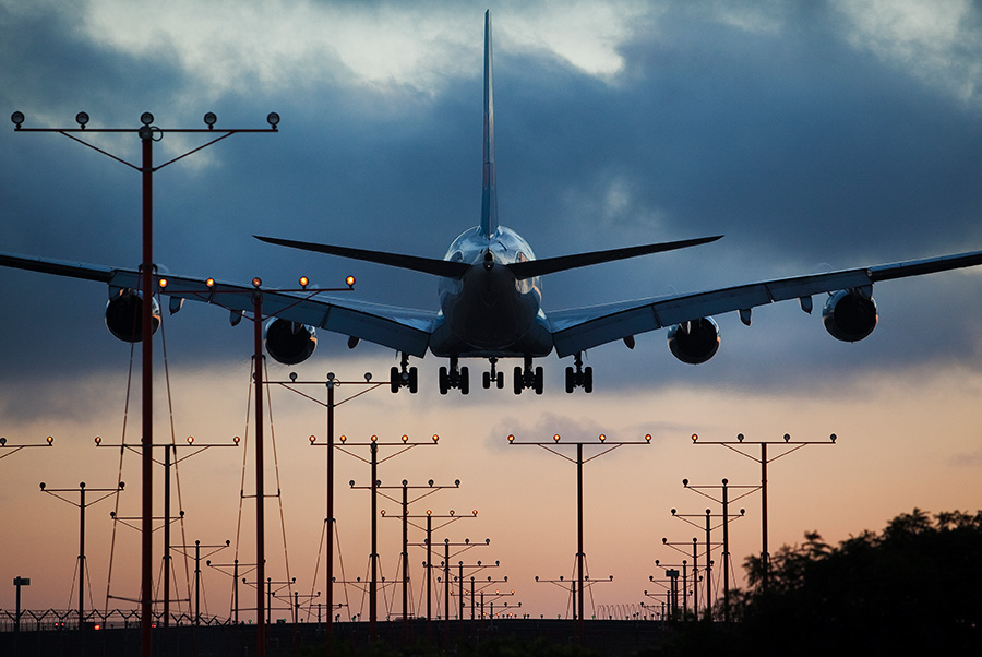 An Airbus A380 plane lands on the north runway at Los Angeles International Airport (LAX). Photo by John Schreiber.