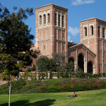 A student sits on a hillside on the campus of UCLA . Photo by John Schreiber.