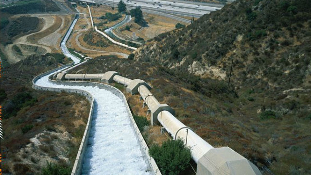 View looking down aqueduct cascades towards a filtration plant and the Los Angeles Reservoir. Photo by  Jet Lowe. Courtesy Library of Congress Prints and Photographs Division.