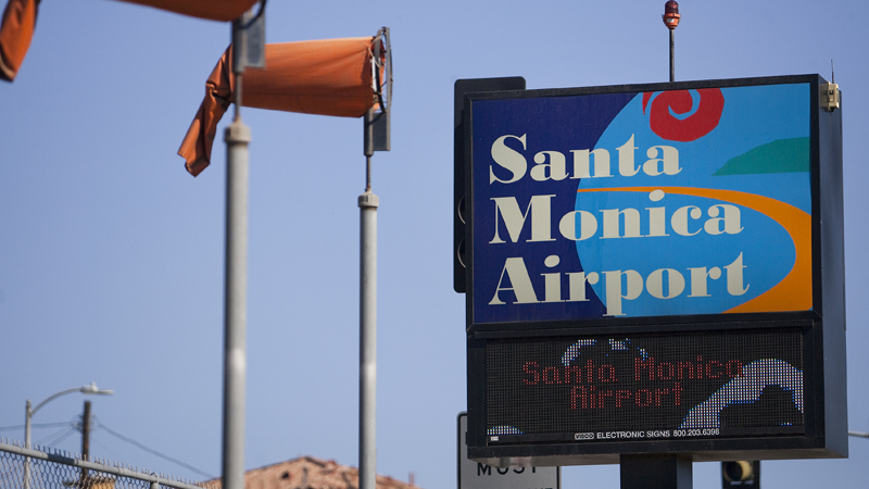 The Santa Monica Airport sign and wind indicator flags.