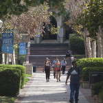 students walk along a path at ucla campus