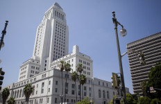 a view of the Los Angeles City Hall tower on a sunny day.