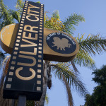 a culver city sign with palm trees