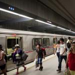 passengers walking quickly through a metro red line station underground