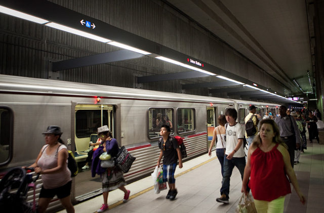 passengers walking quickly through a metro red line station underground