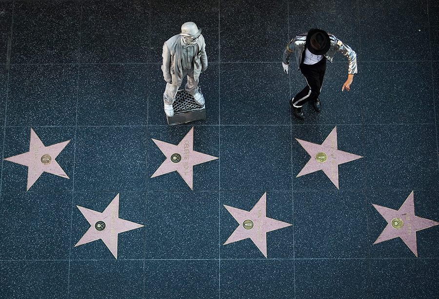 Costumed characters, including a Michael Jackson impersonator perform for tips on Hollywood Boulevard. Photo by John Schreiber.