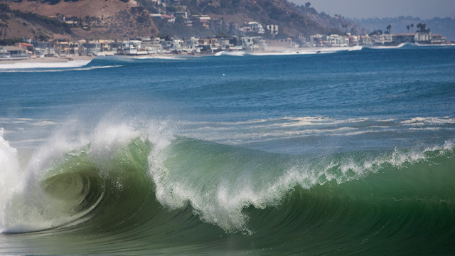 Large waves hit the shores of Malibu. Photo by John Schreiber.