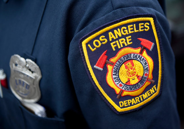 A Los Angeles Fire Department patch and badge.