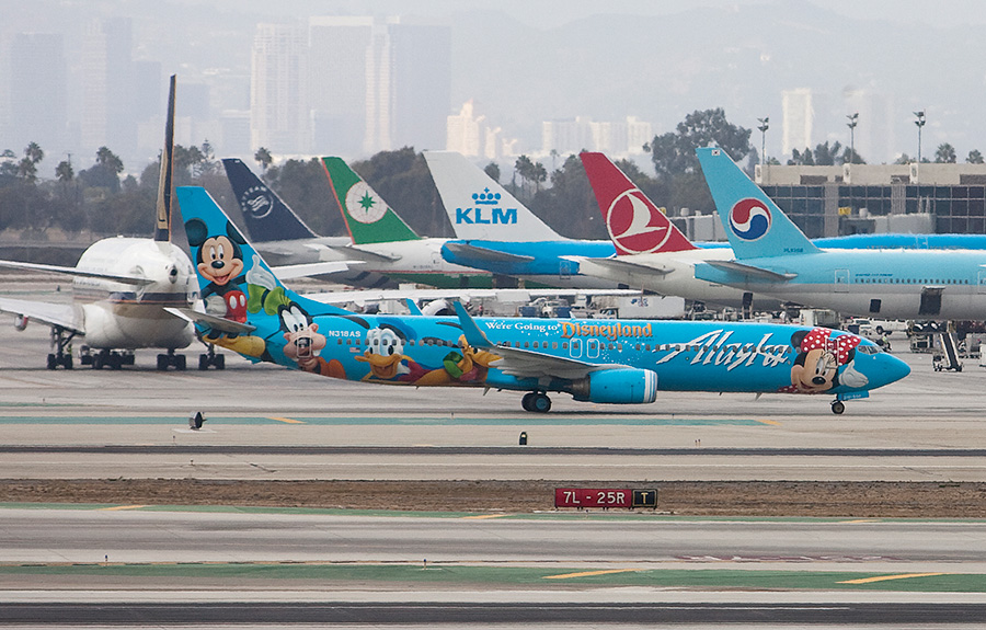 Planes taxi across the tarmac at Los Angeles International Airport. Photo by John Schreiber.
