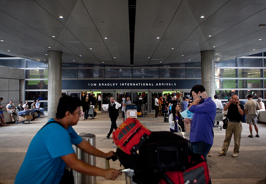 Travelers arrive a the Tom Bradley International Terminal at LAX. Photo by John Schreiber.