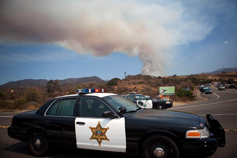The Silverado Canyon fire sends thick smoke into the air Friday as fire crews work to contain the blaze. Photo by John Schreiber.