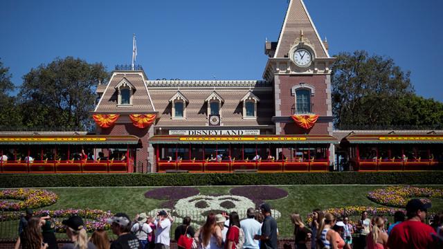 Visitors enter the Disneyland theme park in Anaheim. Photo by John Schreiber.