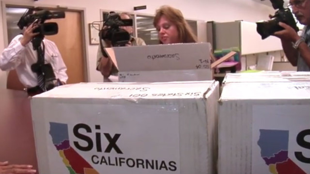 A campaign worker loads boxes with ballot petitions. Courtesty Six Californias campaign