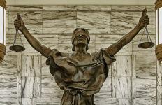 Lady Justice sculpture. Photo via Pixabay