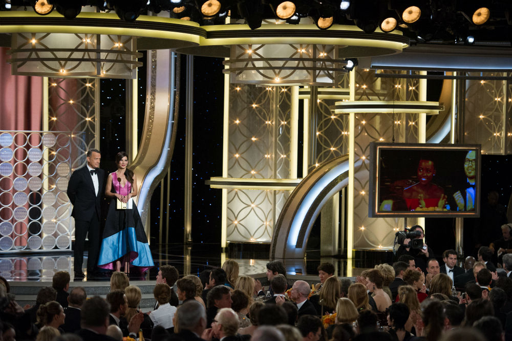 Presenters Tom Hanks and Sandra Bullock on stage during the 71st Annual Golden Globe Awards at the Beverly Hilton in Beverly Hills, CA on Sunday, January 12, 2014. Photo © HFPA