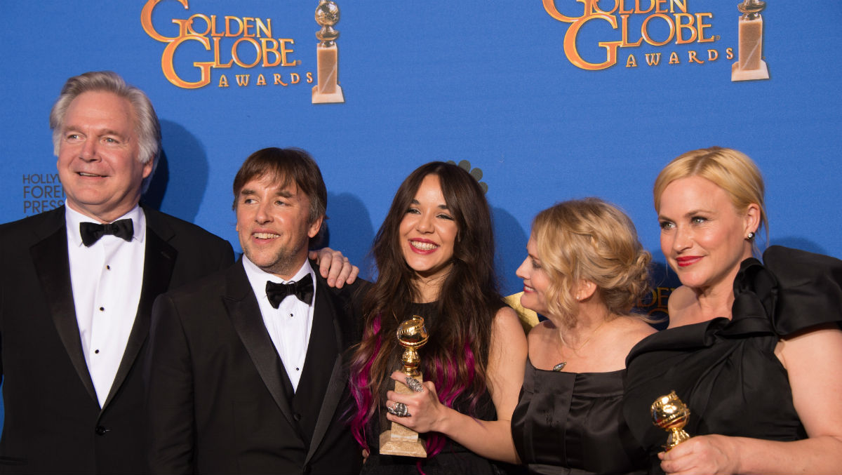 """Boyhood"" producers director and actors pose with their awards for Best Motion Picture -Drama at the 2015 Golden Globe Awards. Photo © HFPA."