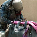 A homeless person with their possessions. Photo via Pixabay