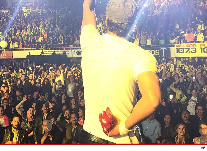 Enrique Iglesias with his bloody hand at a concert near Tijuana. Photo courtesy of TMZ