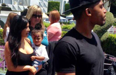 Kim Kardashian holds birthday girl North, 2, while dad Kanye West leads way at Disneyland. Image via Twitter