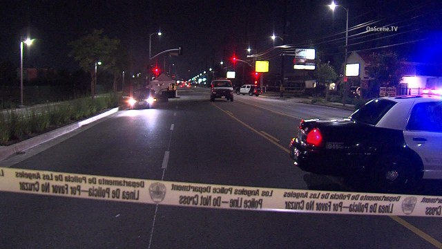 A man was killed when he stepped off a Canoga Park curb with his skateboard in front of a car that had the right of way, a police sergeant said. Photo via OnScene.TV.