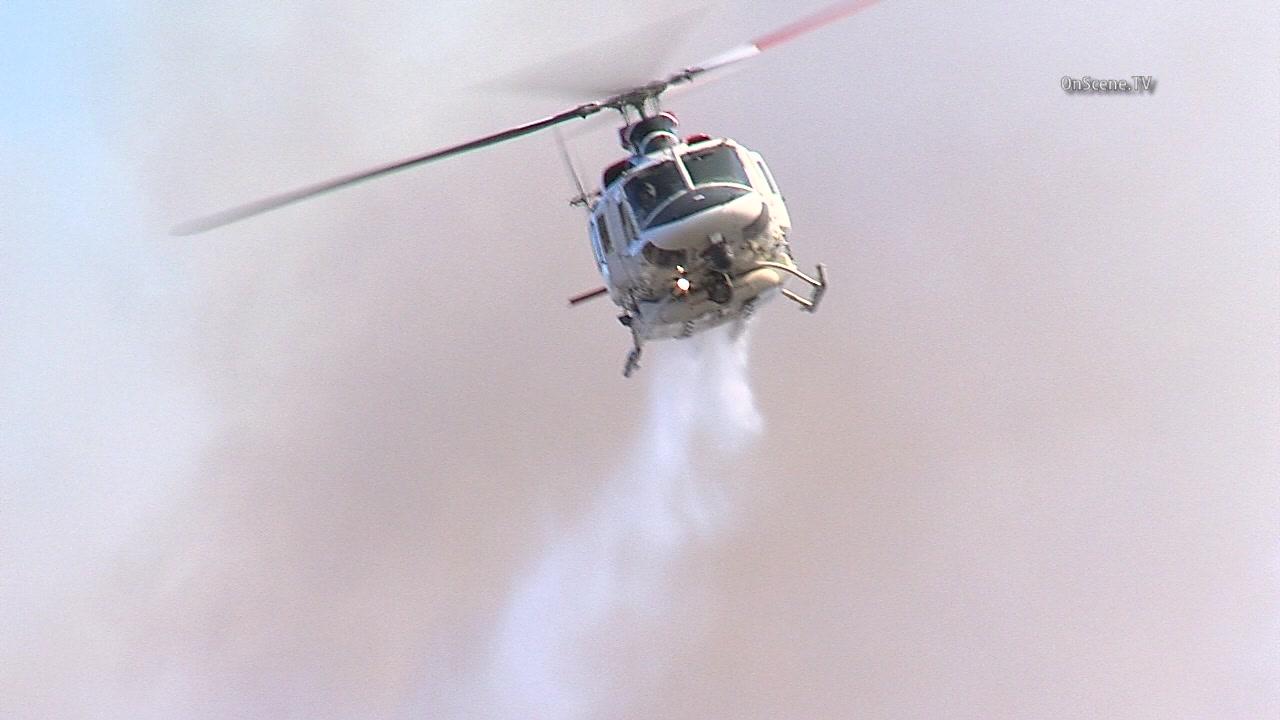 Massive Santa Clarita fire rages, evacuations amid soaring