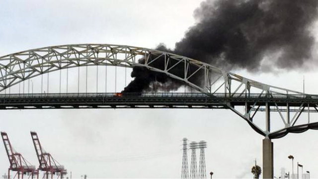 Smoke billowing from the Gerald Desmond Bridge where a wrong-way drive caused a fiery crash. Photo courtesy of the Long Beach Fire Department