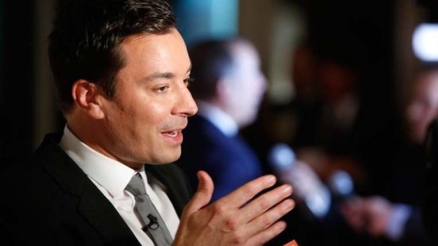 Television show host Jimmy Fallon talks to reporters on the red carpet for the taping of the Mark Twain Prize for Humor ceremony and performance at the Kennedy Center in Washington October 19, 2014.  Photo by Jonathan Ernst via Reuters