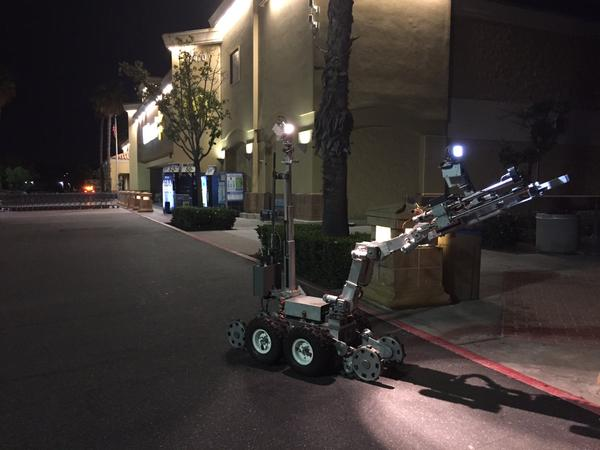 A bomb disposal robot examining a suspicious package at a Laguna Niguel Walmart. Photo courtesy of the Orange County Sheriff's Department