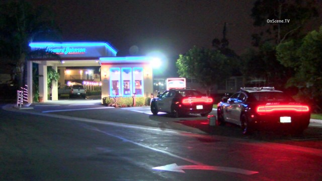 Two men held up the Howard Johnson Inn and Suites in Orange at knifepoint . Photo via OnScene.TV.