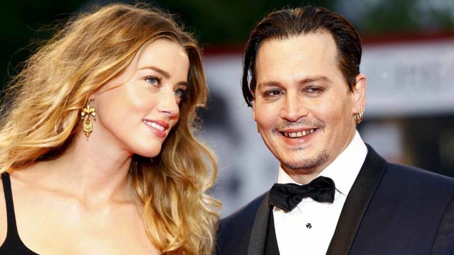 """Actor Johnny Depp (R) and his wife Amber Heard (L) attend the red carpet event for the movie """"Black Mass"""" at the 72nd Venice Film Festival in northern Italy September 4, 2015. REUTERS/Stefano Rellandini"""