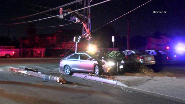 A car crashed into a power pole in Anaheim today, knocking out power to thousands of customers. Photo via OnScene.TV