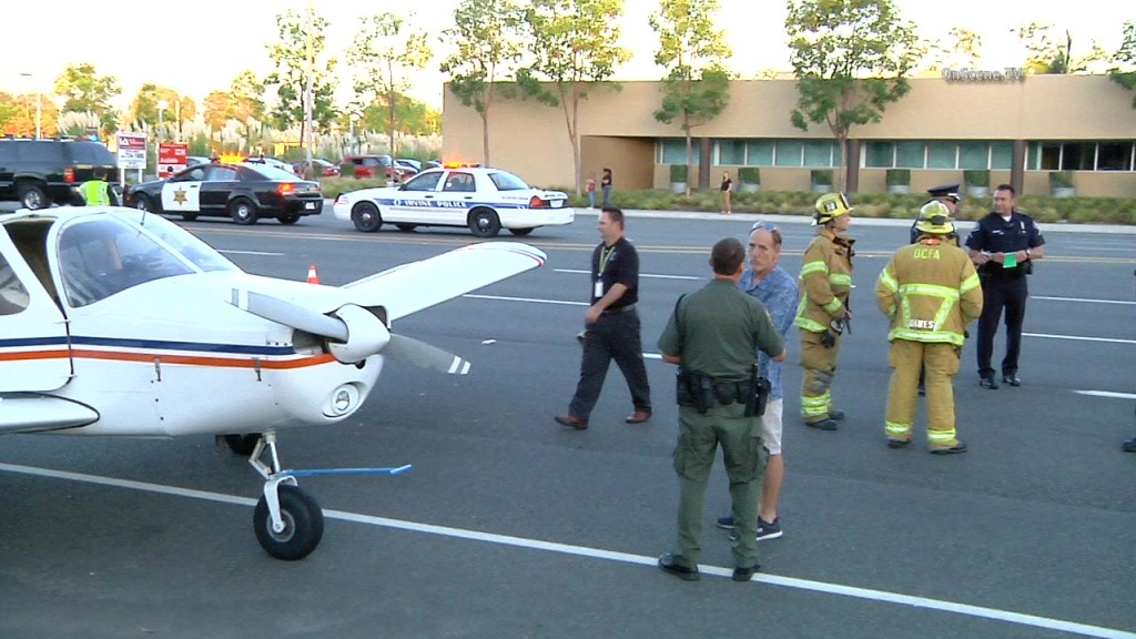 A small plane made an emergency landing on an Irvine street Wednesday. No one was injured. Photo courtesy of OnSceneTV