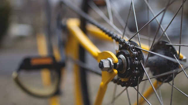 A bicycle's wheel, spokes, pedal and gears. Photo via Pixabay