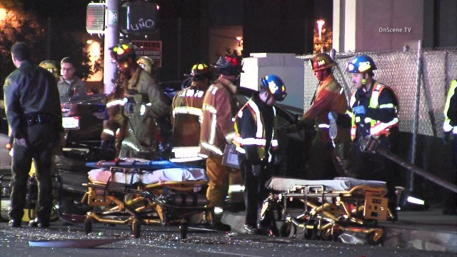 Firefighters with victims of the crash in Lynwood. Courtesy OnScene.TV