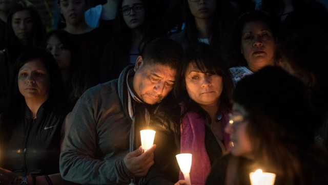 Nohemi Gonzalez's mother, Beatriz (pink scarf), and step father, Jose Hernandez join hundreds others in mourning her loss at a candlelight vigil at CSU Long Beach. Photo via CSU Long Beach