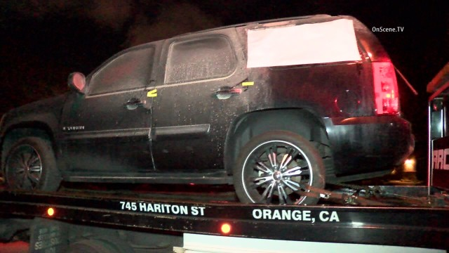 Authorities today conducted a homicide investigation in Orange, where three bodies were found in a burned SUV. Photo via OnScene.TV