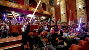 """Moviegoers cheer and wave lightsabers before the first showing of the movie """"Star Wars: The Force Awakens"""" at the TCL Chinese Theatre in Hollywood on Dec. 17, 2015.   Photo by   Mario Anzuoni via Reuters"""