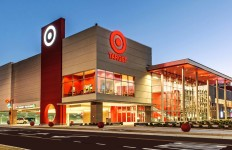 the exterior of a Target store, lit up, at dusk