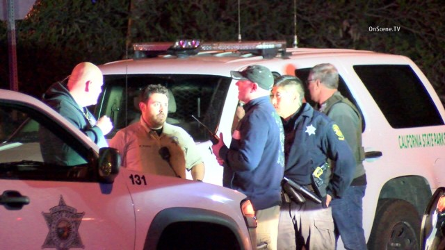A man and a woman were arrested after a search that began when one of them allegedly shot at two park rangers at Dana Point. Photo via OnScene.TV.