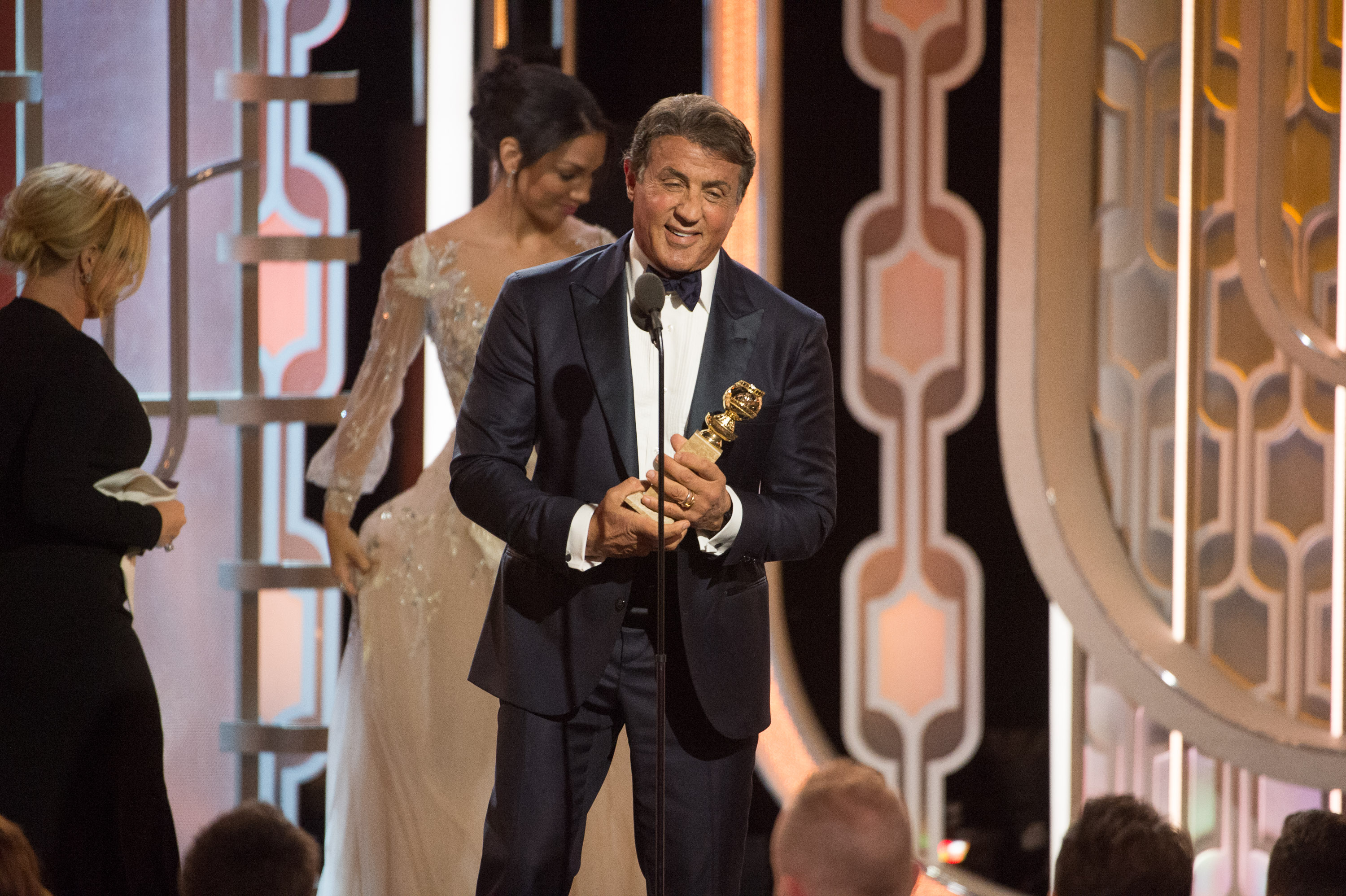 """Sylvester Stallone accepts the Golden Globe Award for BEST PERFORMANCE BY AN ACTOR IN A SUPPORTING ROLE IN A MOTION PICTURE for his role in """"Creed"""" at the 73rd Annual Golden Globe Awards at the Beverly Hilton in Beverly Hills, CA on Sunday, January 10, Courtesy of Hollywood Foreign Press Association"""