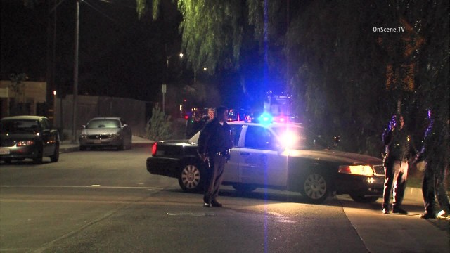 LA SWAT officers fired tear gas into a house in Northridge  flushing out seven people in whom they had no interestsuspect they were seeking -- a man wanted for an alleged parole violation. Photo via OnScene.TV.
