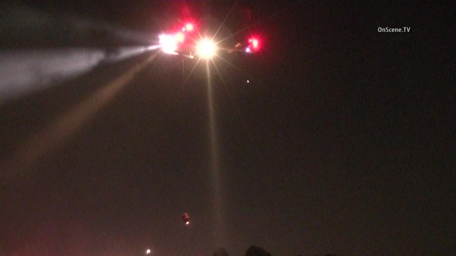 Two men and two women were hoisted to safety by a helicopter off a cliff in Hacienda Heights tonight, authorities said. Photo via OnScene.TV.
