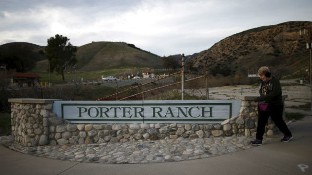 A woman walks past a Porter Ranch sign at the entrance to Southern California Gas Co.'s Aliso Canyon storage field. REUTERS/Lucy Nicholson