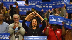 Film and TV star Rosario Dawson made a love symbol to the audience before introducing Bernie Sanders. Photo by Chris Stone