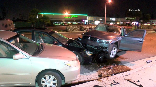 At least four people were hurt when a wrong-way driver crossed over the median strip and struck several cars on a road in Huntington Beach, police said today.