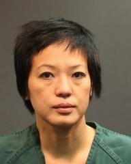 Trang Thu Pham is suspected of stealing Buddhist statues.