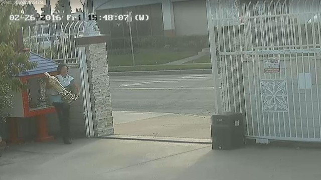 A woman is shown stealing a statue from a Santa Ana temple. Courtesy of Santa Ana Police